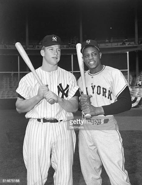 Mickey Mantle of the New York Yankees poses with Willie Mays of the New York Giants at Yankee Stadium prior to the World Series