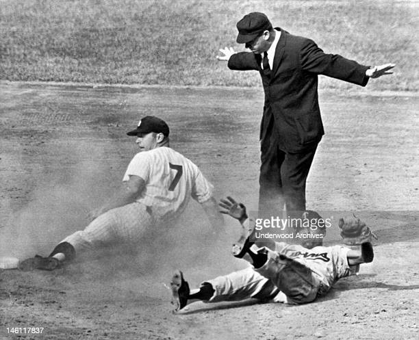 Mickey Mantle of the New York Yankees steals second in the 11th inning of a game at Yankee Stadium against the Minnesota Twins New York New York...