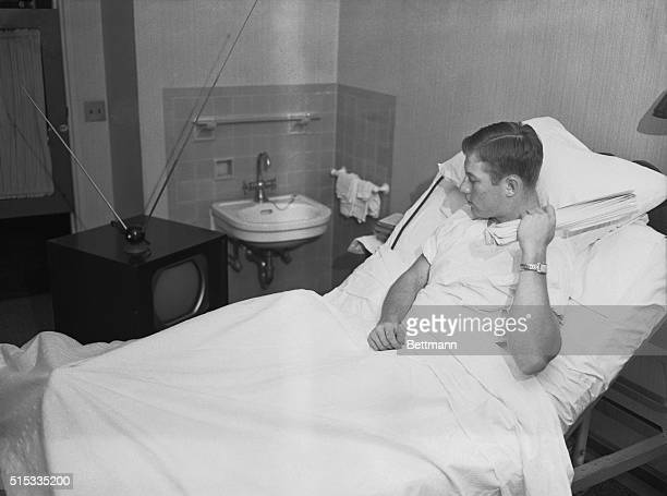 Mickey Mantle Yankee fielder who sprained his knee in the world Series game at Yankee Stadium October 5 watches a television broadcast the following...