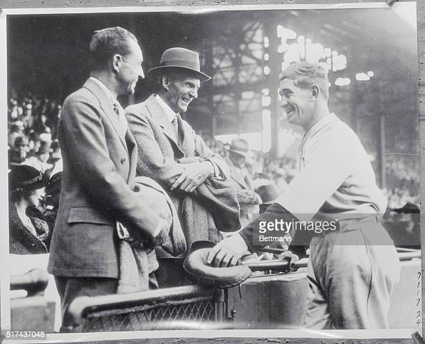 Mickey Meets Detroit's First Citizens. Detroit, Michigan: Edsel Ford, and his dad, Henry Ford watched Mickey Cochrane and his playmates of the...