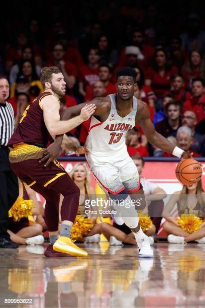 Mickey Mitchell of the Arizona State Sun Devils defends Deandre Ayton of the Arizona Wildcats during the first half of the college basketball game at...