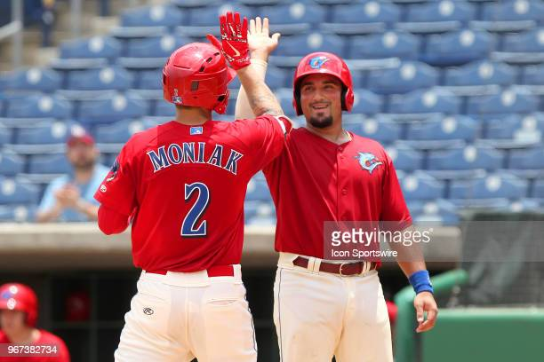 Mickey Moniak of the Threshers is greeted at home plate by Austin Listi during the Florida State League game between the Florida Fire Frogs and the...