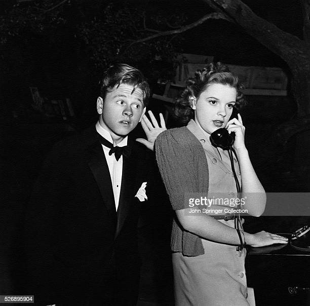 Mickey Moran listens as Patsy Barton talks on the telephone in the 1939 film Babes in Arms