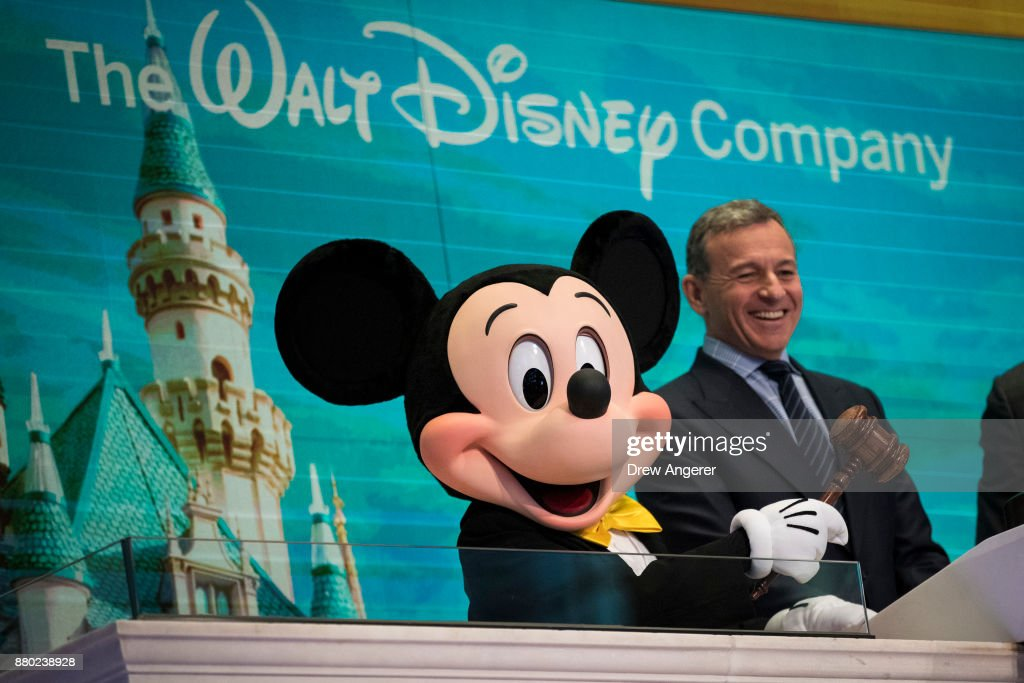 Mickey Mouse and chief executive officer and chairman of The Walt Disney Company Bob Iger prepare to ring the opening bell at the New York Stock Exchange (NYSE), November 27, 2017 in New York City. Disney is marking the company's 60th anniversary as a listed company on the NYSE.