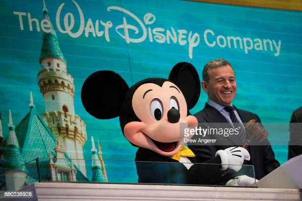 Mickey Mouse and chief executive officer and chairman of The Walt Disney Company Bob Iger prepare to ring the opening bell at the New York Stock...