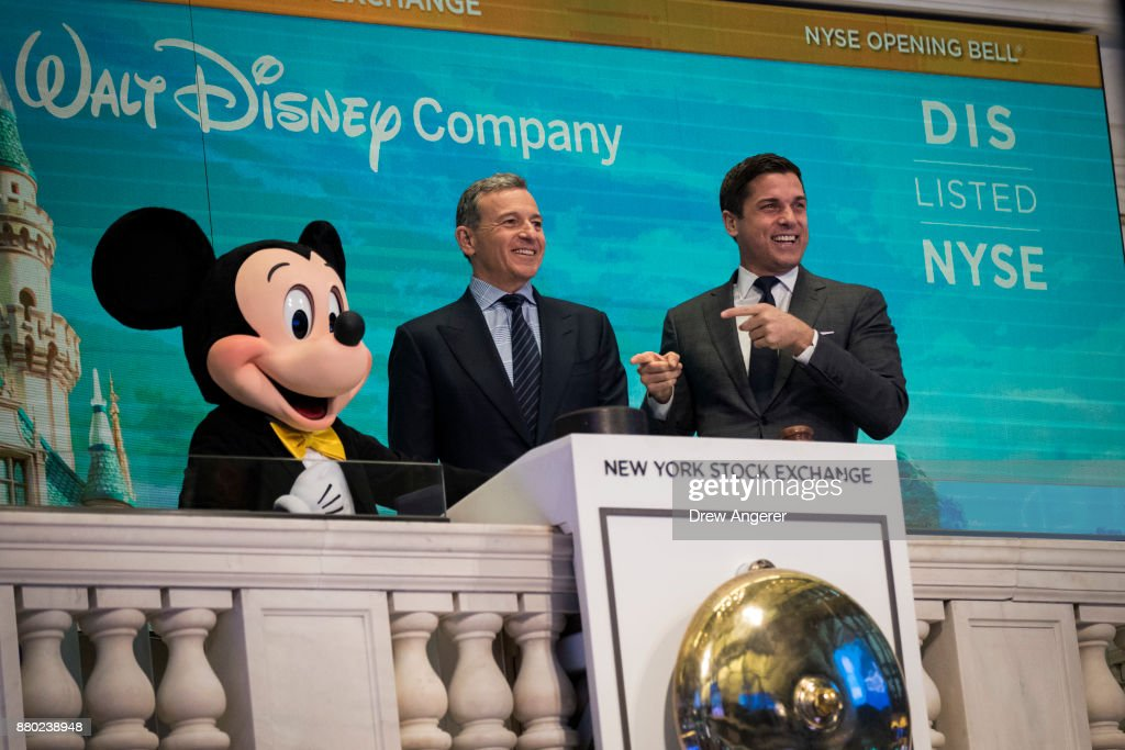 Mickey Mouse and chief executive officer and chairman of The Walt Disney Company Bob Iger ring the opening bell at the New York Stock Exchange (NYSE), November 27, 2017 in New York City. Disney is marking the company's 60th anniversary as a listed company on the NYSE.