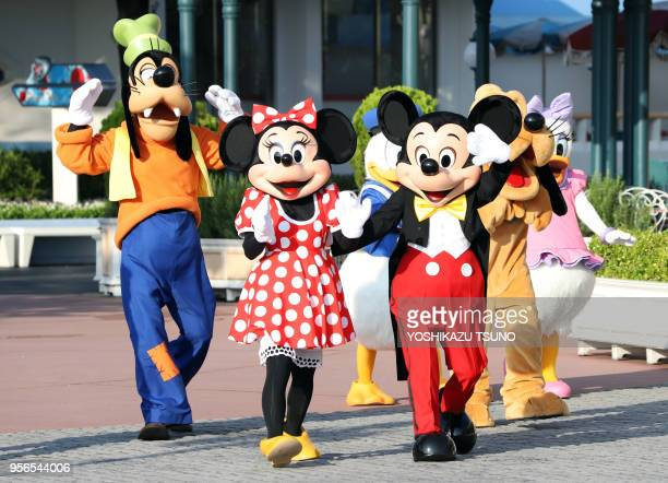 Mickey Mouse and Disney characters greet runners dressed in costumes of Disney characters and movies as they participate Disney Halloween Fun and Run...