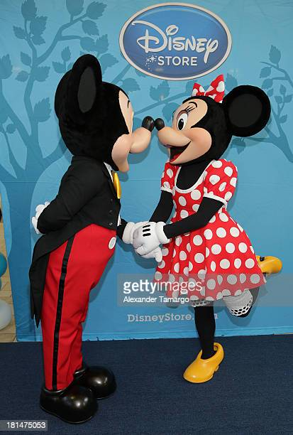 Mickey Mouse and Minnie Mouse are seen at the Disney Store grand opening at Miami International Mall on September 21 2013 in Miami Florida