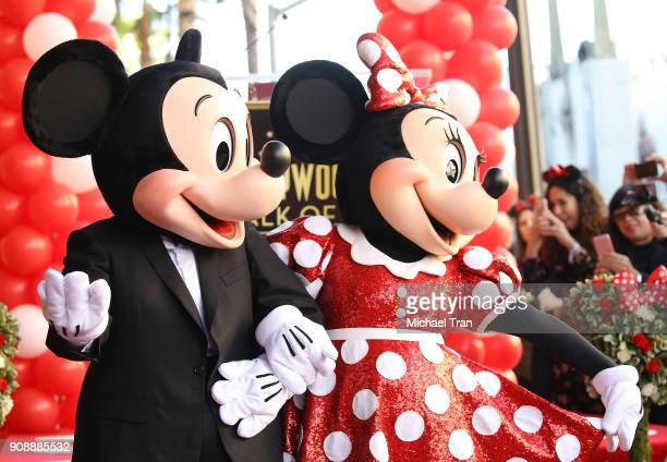 Mickey Mouse and Minnie Mouse attend the ceremony honoring Disney's Minnie Mouse 90th Anniversary with a Star on The Hollywood Walk of Fame held on...