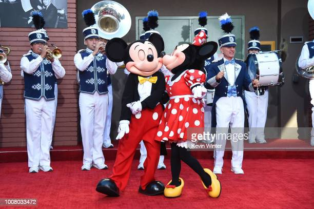 Mickey Mouse and Minnie Mouse attend the stage dedication to the Sherman Brothers during the premiere of Disney's 'Christopher Robin' at Walt Disney...