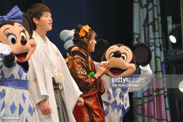Mickey Mouse and Minnie Mouse join the celebration at the coming of age ceremony at Tokyo Disneyland on January 8 2018 in Urayasu Chiba Japan