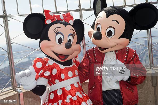 Mickey Mouse and Minnie Mouse of Disney Live MickeyÕs Music Festival visits The Empire State Building on March 20 2013 in New York City