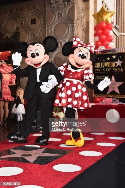 Mickey Mouse and Minnie Mouse pose during a star ceremony in celebration of the 90th anniversary of Disney's Minnie Mouse at the Hollywood Walk of...