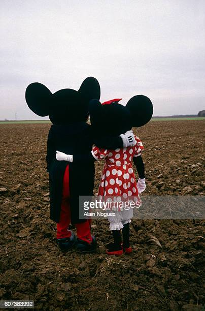 Mickey Mouse and Minnie Mouse visit the site of the future Disneyland in Marne La Vallee.