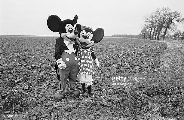 Mickey Mouse and Minnie Mouse visit the site of the future Disneyland in Marne La Vallee