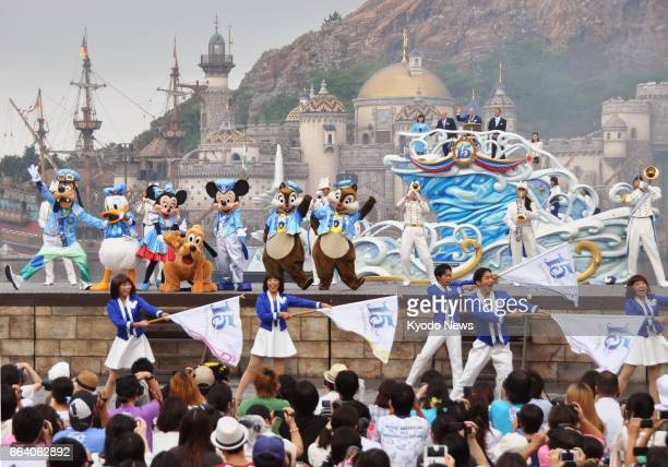 Mickey Mouse and other Disney characters dance during a ceremony marking the 15th anniversary of Tokyo DisneySea in Urayasu Chiba Prefecture in this...