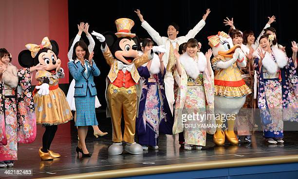 Mickey Mouse and other Disney characters welcomes 20yearold local residents dressed in kimonos during the ceremony for their 'ComingofAge Day'...