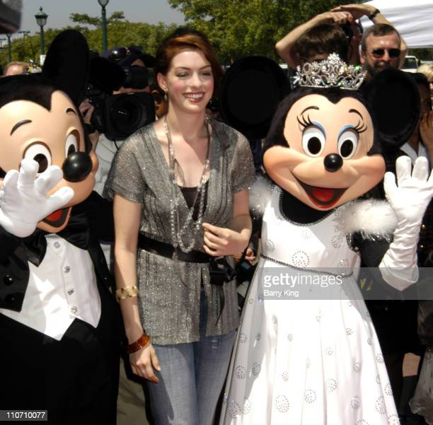 Mickey Mouse Anne Hathaway and Minnie Mouse during 'The Princess Diaries 2 Royal Engagement' World Premiere Arrivals at AMC Downtown Disney in...