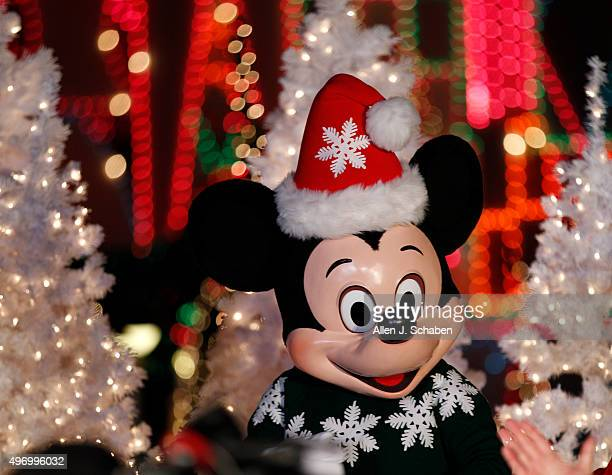 ANAHEIM CALIF THURSDAY NOVEMBER 12 2015 Mickey Mouse appears during the lighting of 'It's a Small World' ride which was decorated for the holiday...