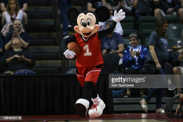 Mickey Mouse brings the game ball to the court before the first game of the 2018 AdvoCare Invitational mens college basketball game between the...
