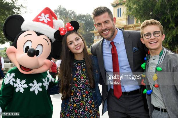 Mickey Mouse dons his holiday finest for a photo with actress Olivia Rodrigo from Disney Channel's Bizaardvark sports star and commentator Jesse...
