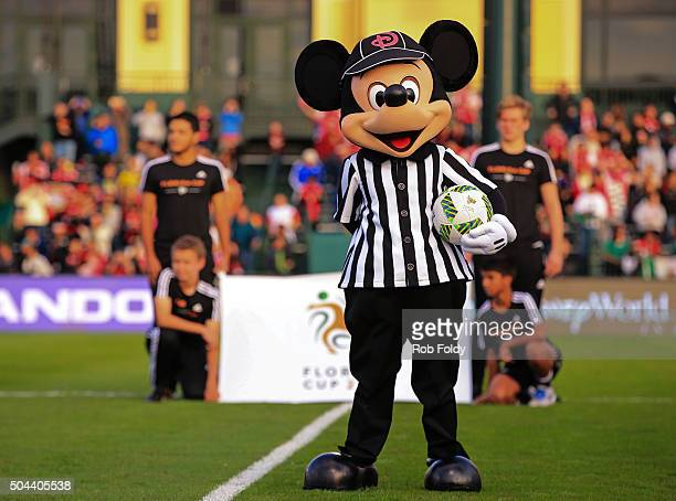Mickey Mouse holds a ball before the match between the Bayer Leverkusen and Indepediente Santa Fe at the ESPN Wide World of Sports Complex on January...