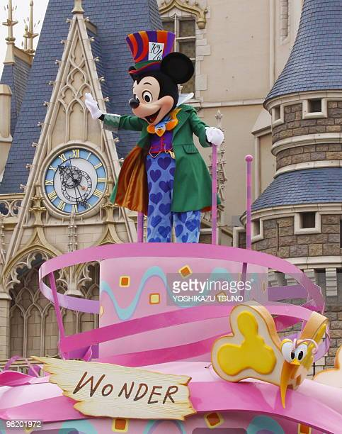 Mickey Mouse in clad of Mad Hatter performs on the float during the press preview for the new parade 'Disney Easter Wonderland' at the Tokyo...