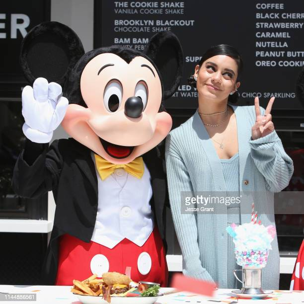 Mickey Mouse joins actor Vanessa Hudgens, May 18 to celebrate the opening of Black Tap Craft Burgers & Shakes in the Downtown Disney District at...