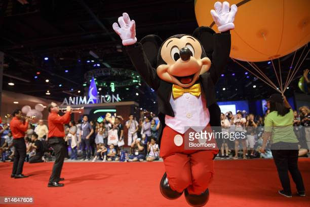 Mickey Mouse jumps during an indoor parade at the D23 Expo 2017 in Anaheim California US on Friday July 14 2017 Burbank Californiabased Disney will...