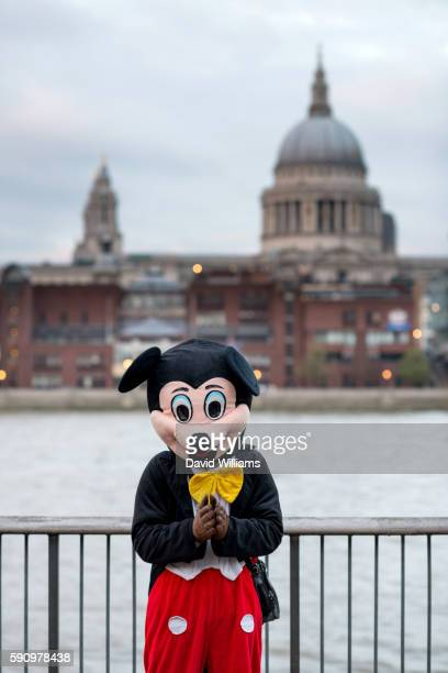 Mickey Mouse on the banks of the River Thames, London with St Paul's Cathedral in the background