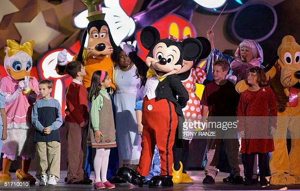 Mickey Mouse performs during the 100 Years of Magic celebration at Disney MGM Studios at Walt Dinsney World in Lake Buena Vista Florida 05 December...