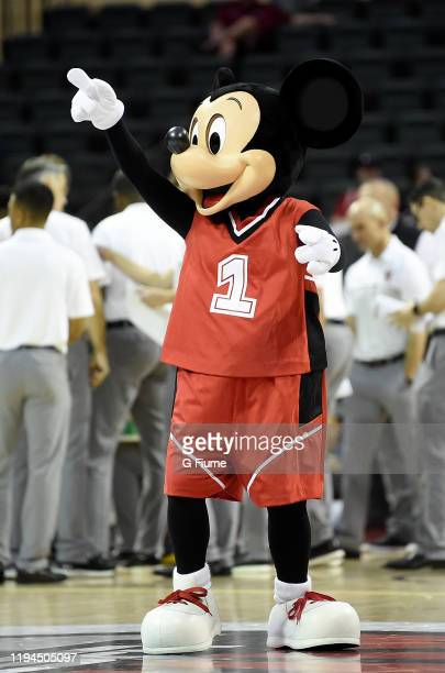 Mickey Mouse performs during the game between the Maryland Terrapins and the Temple Owls at HP Field House on November 28 2019 in Orlando Florida