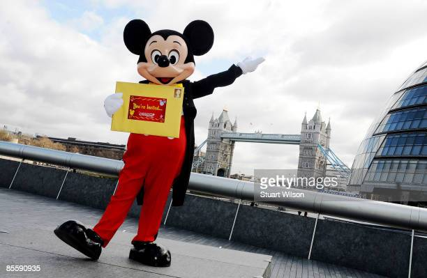 Mickey Mouse poses for photographers to invite guests to Mickey's Magical Party at Disneyland Paris in front of Tower Bridge in on March 25th 2009 in...