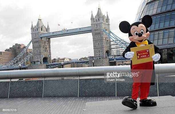 Mickey Mouse poses for photographers to invite guests to Mickey's Magical Party at Disneyland Paris in front of Tower Bridge on March 25 2009 in...