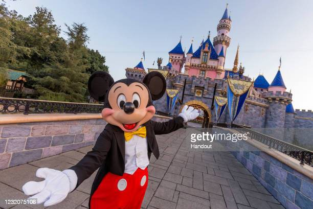 Mickey Mouse poses in front of Sleeping Beauty Castle at Disneyland Park on August 27, 2019 in Anaheim, California. Disneyland plans to reopen on...