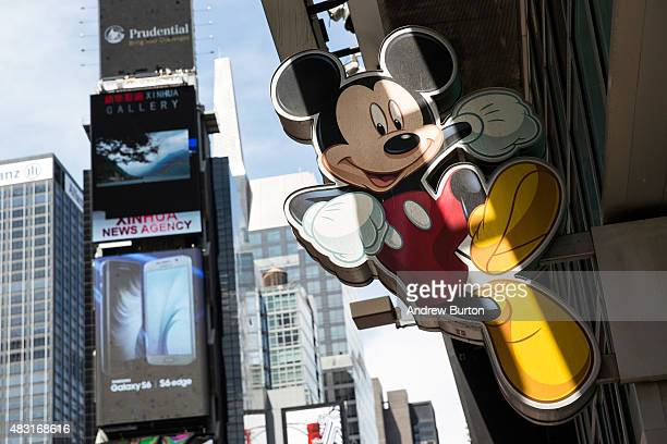 Mickey Mouse sign hangs on the Disney store in Times Square on August 6 2015 in New York City Stock prices of media companies including Disney have...