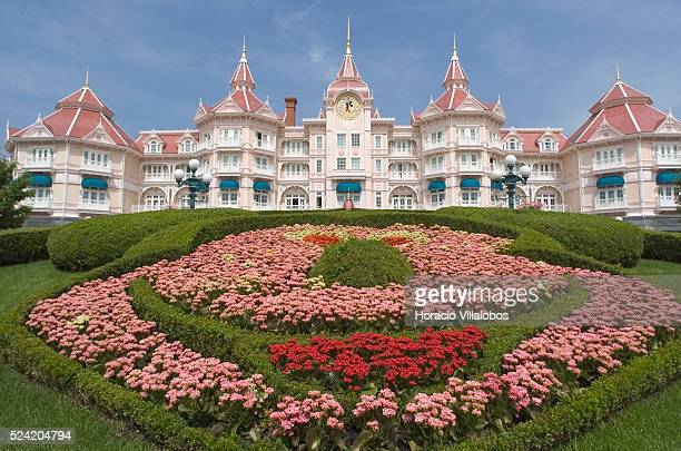Mickey Mouse smiles from a flowerbed at Disneyland Paris as it opens its doors to another quiet day. The company which is facing financial troubles,...