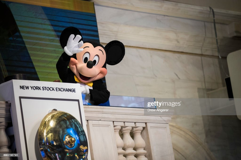 Mickey Mouse, the mascot of The Walt Disney Company, waves before ringing the opening bell at the New York Stock Exchange (NYSE), November 27, 2017 in New York City. Disney is marking the company's 60th anniversary as a listed company on the NYSE.