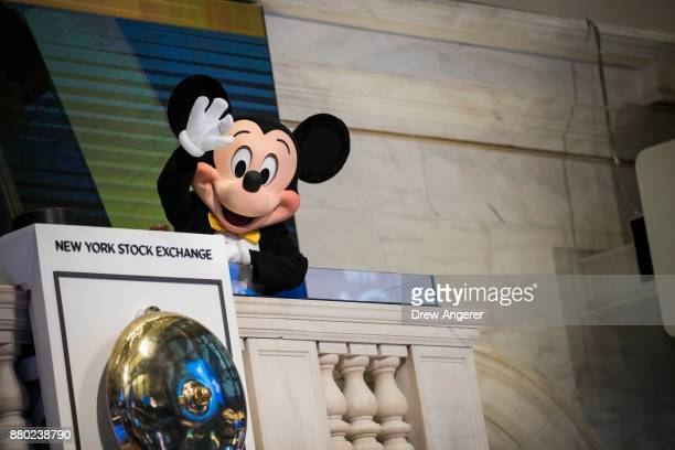 Mickey Mouse the mascot of The Walt Disney Company waves before ringing the opening bell at the New York Stock Exchange November 27 2017 in New York...