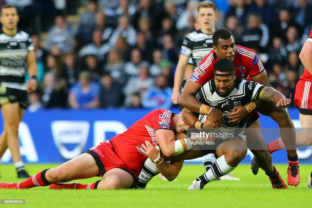 Mickey Paea of Hull FC is tackled by Craig Kopczak and Ben Nakuvuwai of Salford Red Devils during the Betfred Super League match between Hull FC and Salford Red Devils at KCOM Stadium on June 8, 2018 in Hull, England.