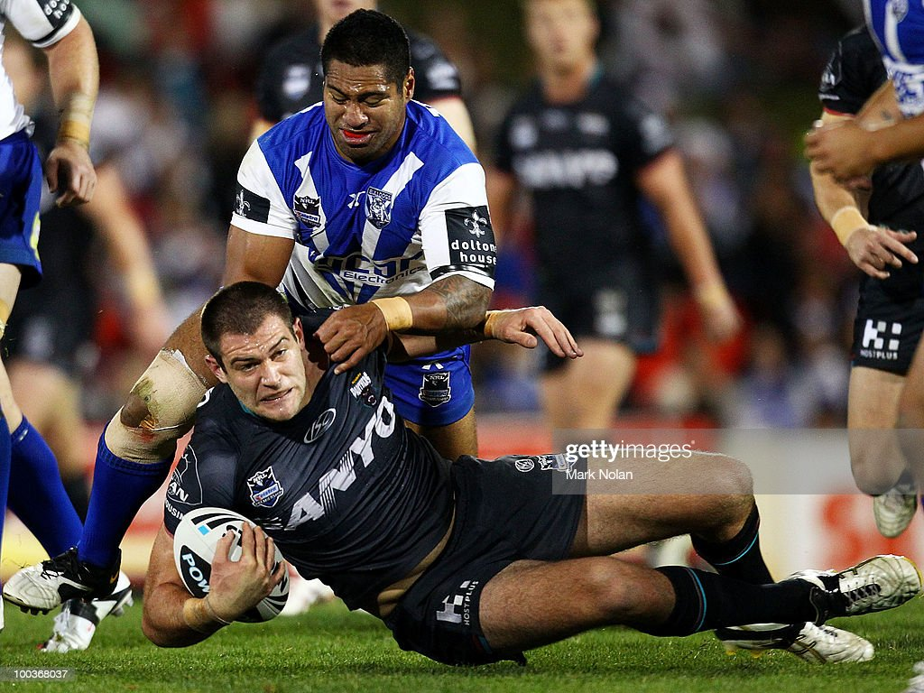 Mickey Paea of the Bulldogs tackles Tim Grant of the Panthers during the round 11 NRL match between the Penrith Panthers and the Canterbury Bulldogs at CUA Stadium on May 24, 2010 in Sydney, Australia.