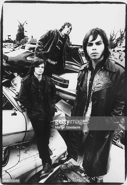 Mickey Quinn Danny Goffey and Gaz Coombes of Supergrass group portrait in a scrapyard Oxford United Kingdom 1994