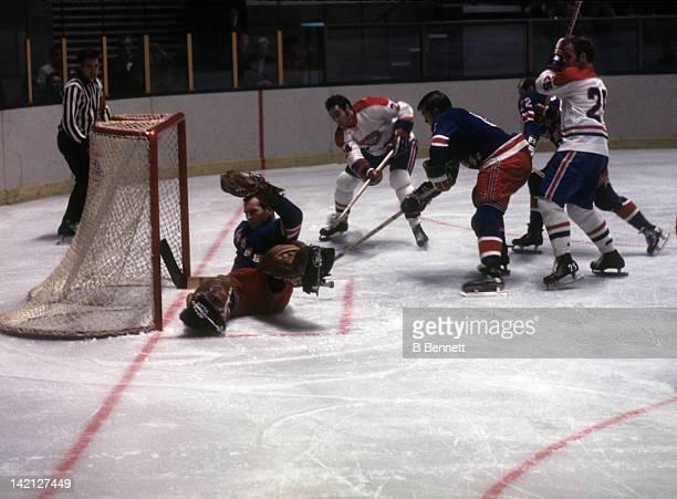 Mickey Redmond of the Montreal Canadiens tries to score on goalie Terry Sawchuk as Jacques Lemaire of the Canadiens battles with Al Hamilton and Don...