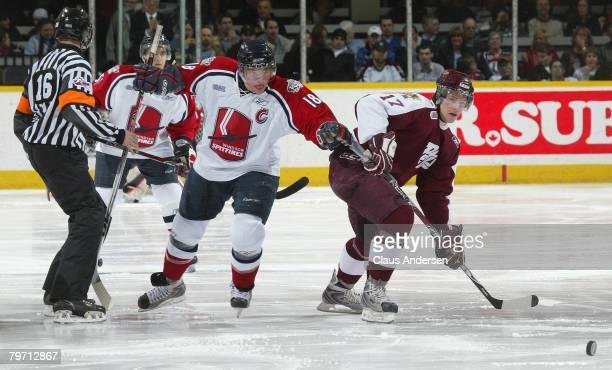 Mickey Renaud of the Windsor Spitfires battles with Zach Harnden of the Peterborough Petes for the puck in a game on February 9 2008 at the...