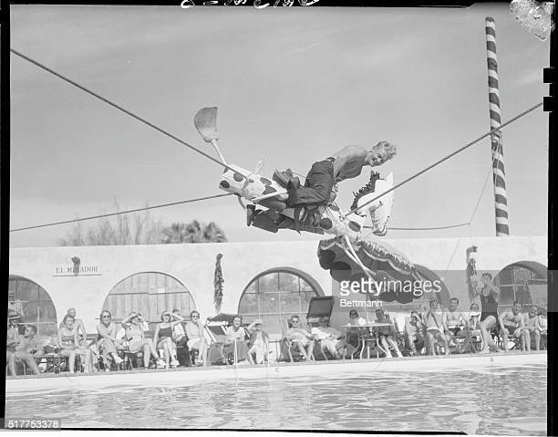 "Mickey Rides ""Witch Hazel,"" at Film Players Playground. Palm Springs, California: Mickey Riley, famous Olympic diver, riding ""Witch Hazel"" over the..."