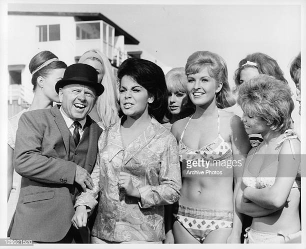 Mickey Rooney and Annette Funicello surrounded by bikini girls in a scene from the film 'How To Stuff A Wild Bikini' 1965