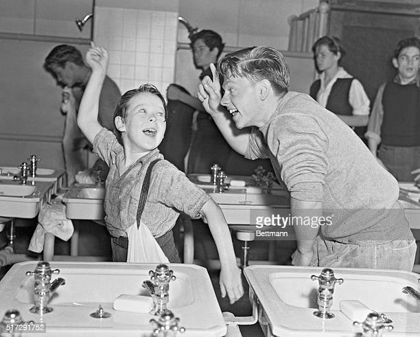 Mickey Rooney and Bobs Watson are shown here in this scene from Men of Boys Town shaking a mean finger It is a Metro Goldwyn Mayer film also starring...