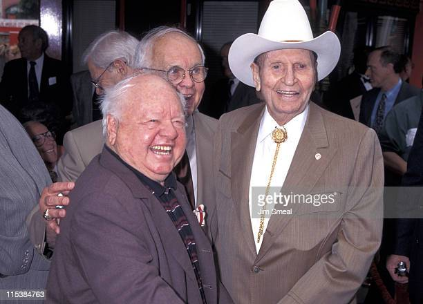 Mickey Rooney Johnny Grant and Gene Autry during Johnny Grant Footprint Ceremony at Mann's Chinese Theatre in Hollywood California United States