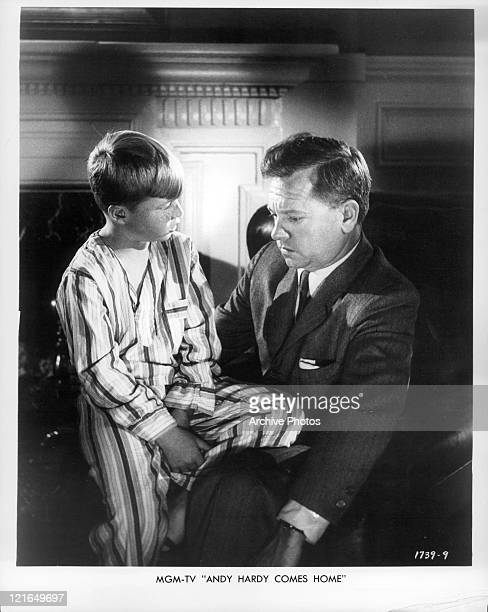 Mickey Rooney sits with a boy on his lap in a scene from the film 'Andy Hardy Comes Home' 1958