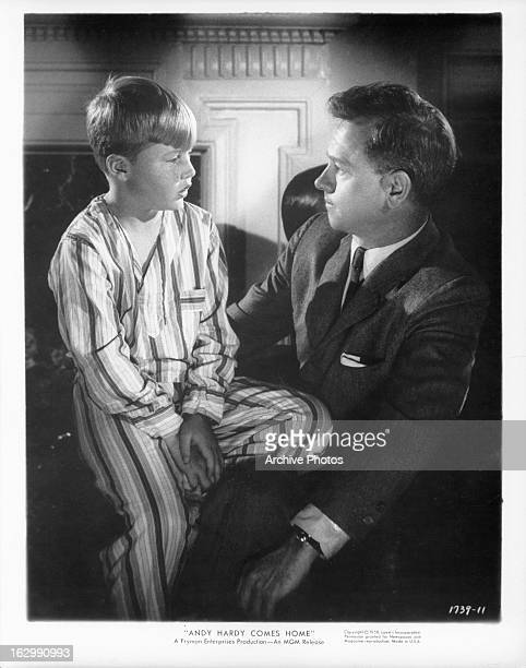 Mickey Rooney talks to his son in a scene from the film 'Andy Hardy Comes Home' 1958